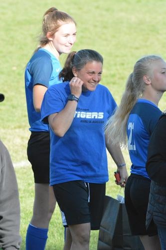 LHS Female soccer coach with a big smile